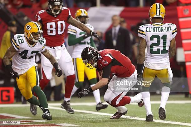 Matt Ryan of the Atlanta Falcons runs for a 14 yard touchdown in the second quarter against Morgan Burnett and Ha Ha ClintonDix of the Green Bay...