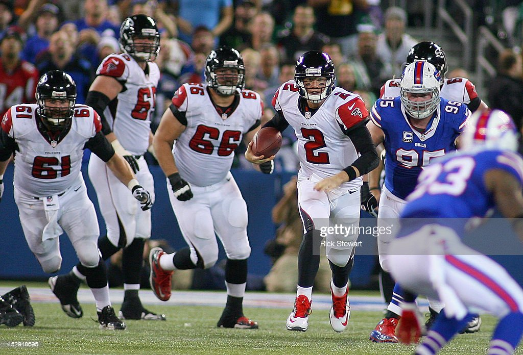 Matt Ryan #2 of the Atlanta Falcons runs for Atlanta Falcons first down against the Buffalo Bills at Rogers Centre on December 1, 2013 in Toronto, Ontario.Atlanta won 34-31 in overtime.