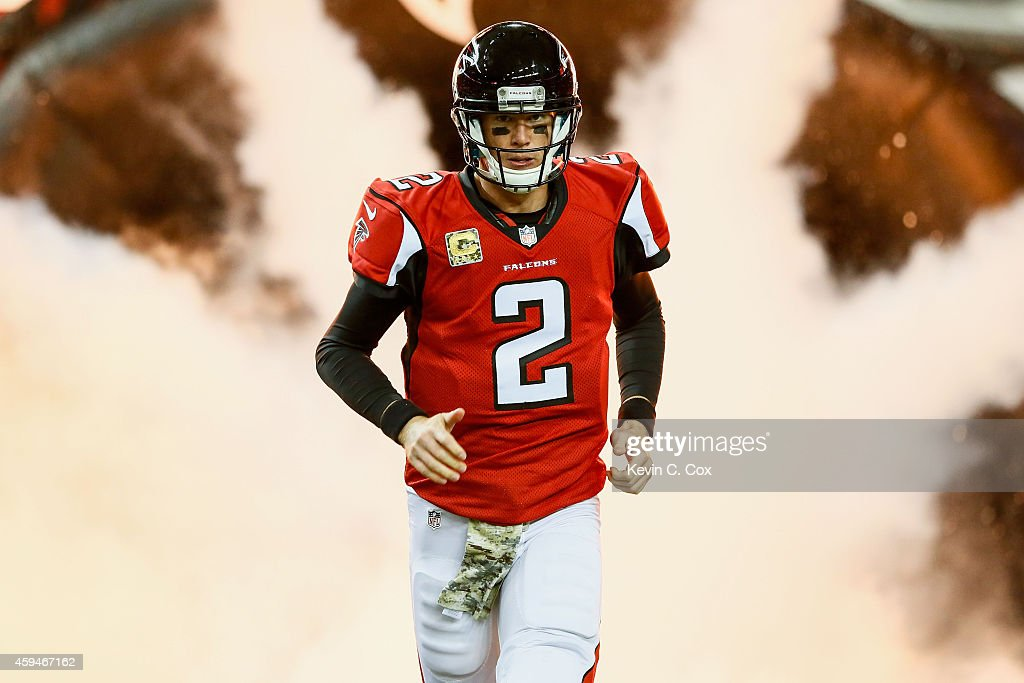 Matt Ryan of the Atlanta Falcons runs out on the field prior to the game against the Cleveland Browns at Georgia Dome on November 23 2014 in Atlanta...