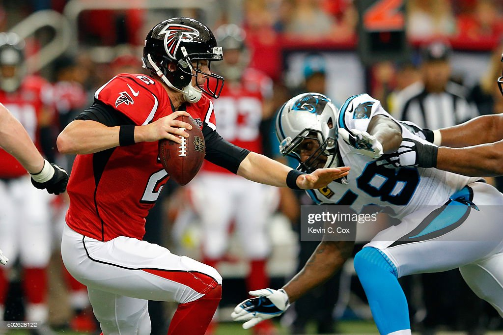 <a gi-track='captionPersonalityLinkClicked' href=/galleries/search?phrase=Matt+Ryan+-+Football+americano&family=editorial&specificpeople=4951318 ng-click='$event.stopPropagation()'>Matt Ryan</a> #2 of the Atlanta Falcons runs the ball during the first half against the Carolina Panthers at the Georgia Dome on December 27, 2015 in Atlanta, Georgia.