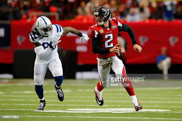 Matt Ryan of the Atlanta Falcons scrambles away from Arthur Jones of the Indianapolis Colts during the first half at the Georgia Dome on November 22...
