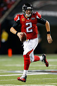 Matt Ryan of the Atlanta Falcons scrambles on a pass play during the first half against the Philadelphia Eagles at the Georgia Dome on September 14...