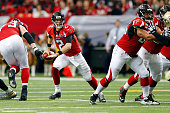 Matt Ryan of the Atlanta Falcons scrambles on a pass play during the first half against the New Orleans Saints at the Georgia Dome on January 3 2016...