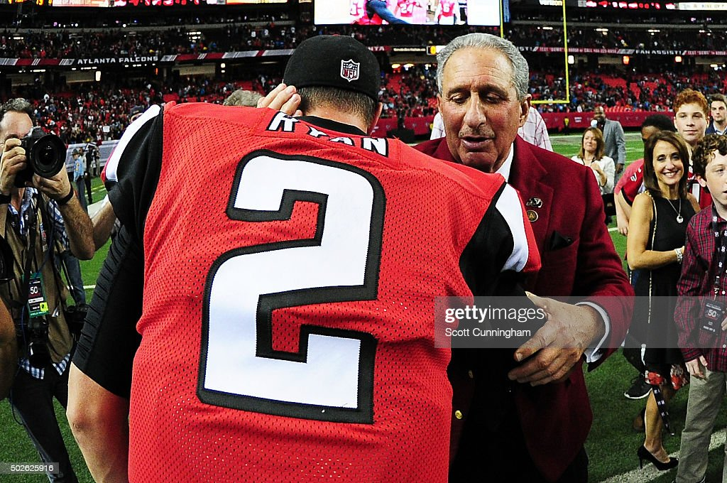 Matt Ryan of the Atlanta Falcons shakes hands with team owner Arthur Blank after beating the Carolina Panthers at the Georgia Dome on December 27...