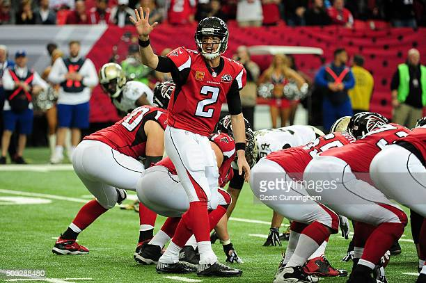 Matt Ryan of the Atlanta Falcons signlas at the line during the second half against the New Orleans Saints at the Georgia Dome on January 3 2016 in...