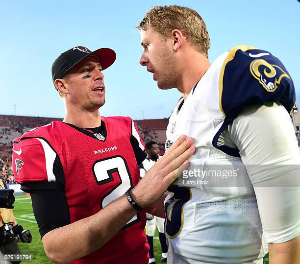 Matt Ryan of the Atlanta Falcons talks with Jared Goff of the Los Angeles Rams after a 4214 Falcon win at Los Angeles Memorial Coliseum on December...