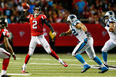 Matt Ryan of the Atlanta Falcons throws a pass on the run in the first half against the Carolina Panthers at the Georgia Dome on December 28 2014 in...