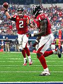 Matt Ryan of the Atlanta Falcons throws a touchdown pass to teammate Julio Jones against the the Dallas Cowboys in the fourth quarter at ATT Stadium...