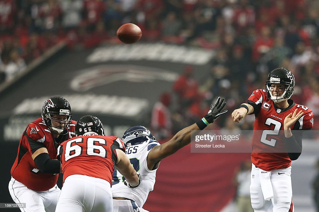 Matt Ryan #2 of the Atlanta Falcons throws against the Seattle Seahawks during the NFC Divisional Playoff Game at Georgia Dome on January 13, 2013 in Atlanta, Georgia.