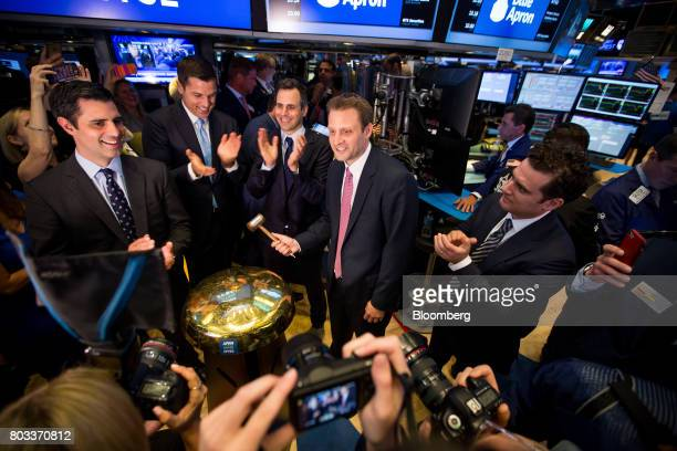 Matt Salzberg cofounder and chief executive officer of Blue Apron Holdings Inc center rings a ceremonial bell with Ilia Papas cofounder and chief...