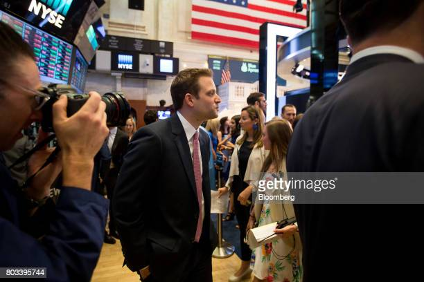 Matt Salzberg cofounder and chief executive officer of Blue Apron Holdings Inc center walks on the floor during the company's initial public offering...