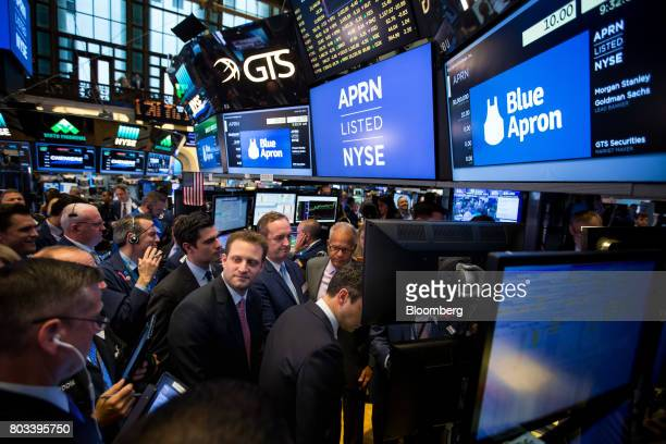 Matt Salzberg cofounder and chief executive officer of Blue Apron Holdings Inc left of center watches traders during the company's initial public...