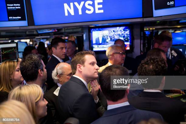 Matt Salzberg cofounder and chief executive officer of Blue Apron Holdings Inc center watches traders during the company's initial public offering on...