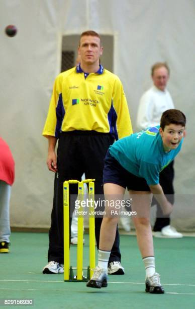 Matt Savage aged 12 from Haydon School in Middlesex bowls as Alec Stewart England Cricketer helps out with coaching at the Middlesex County Final of...