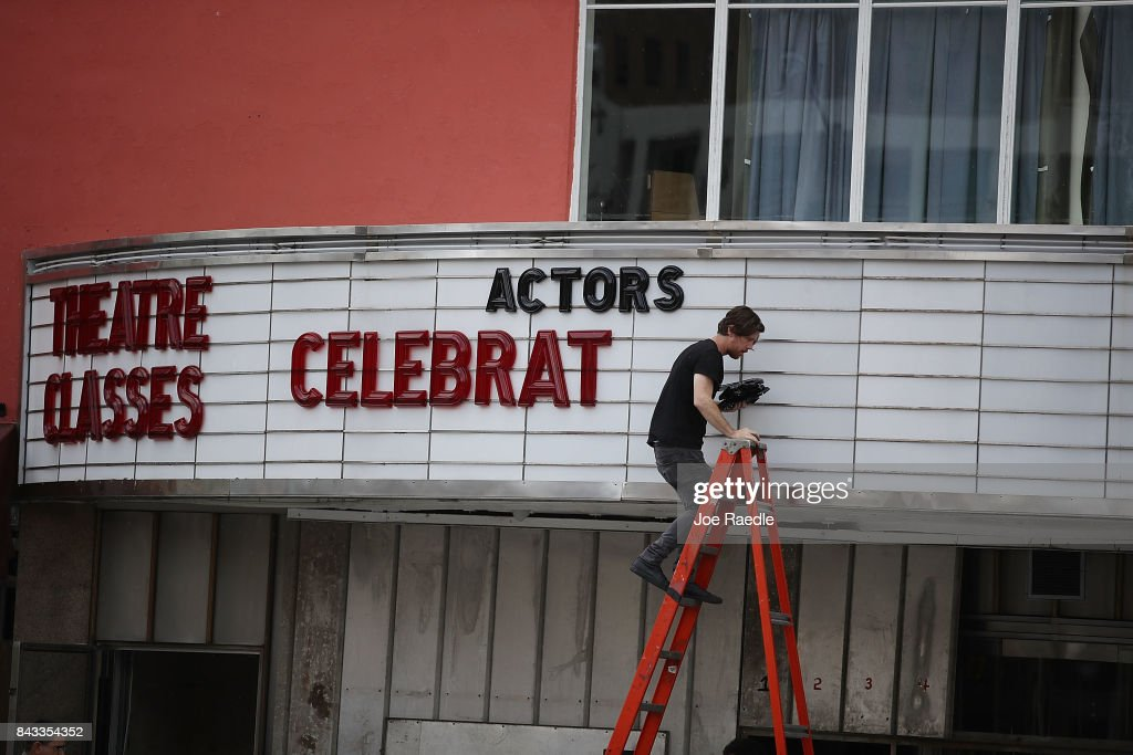 Matt Scally takes the letters of the marquee at the Actors' Playhouse at the Miracle Theatre as they prepare for Hurricane Irma on September 6, 2017 in Miami, Florida. It's still too early to know where the direct impact of the hurricane will take place but the state of Florida is in the area of possible landfall.