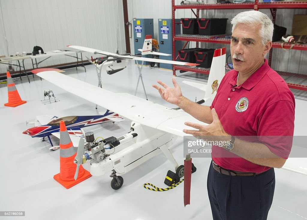 Matt Scassero, director of the University of Maryland's Unmanned Aircraft Systems (UAS) programs, speaks about their drones in a hangar at St. Mary's County Regional Airport in California, Maryland, June 24, 2016. The Federal Aviation Administration has unveiled new rules that clear the way for small, commercial drones to operate across US airspace. Drone operators will be allowed to fly commercial craft weighing less than 55 pounds (25 kilograms) during daylight hours, provided they can maintain a clear view of the drone at all times. LOEB