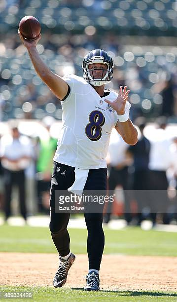 Matt Schaub of the Baltimore Ravens takes practice throws during pregame against the Oakland Raiders at OaklandAlameda County Coliseum on September...