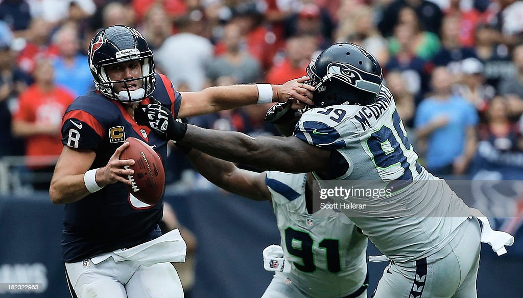 <a gi-track='captionPersonalityLinkClicked' href=/galleries/search?phrase=Matt+Schaub&family=editorial&specificpeople=2210847 ng-click='$event.stopPropagation()'>Matt Schaub</a> #8 of the Houston Texans fights offsides the tackle of Tony McDaniel #99 of the Seattle Seahawks in the second half at Reliant Stadium on September 29, 2013 in Houston, Texas.