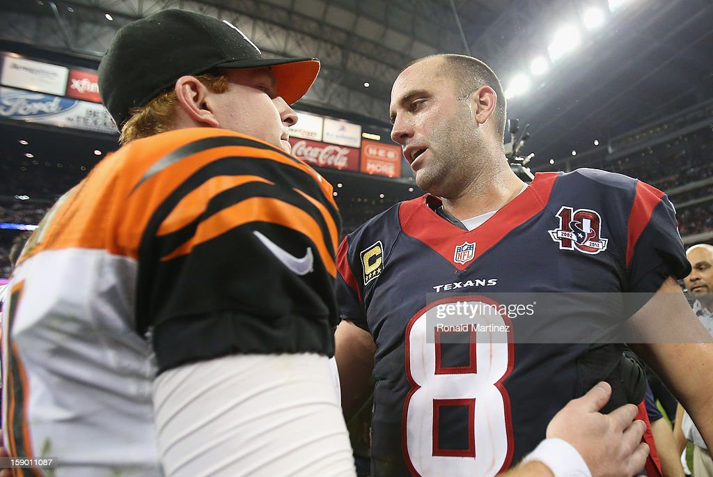 Matt Schaub #8 of the Houston Texans hugs Andy Dalton #14 of the Cincinnati Bengals after a 19-13 win during the AFC Wild Card Playoff Game at Reliant Stadium on January 5, 2013 in Houston, Texas.