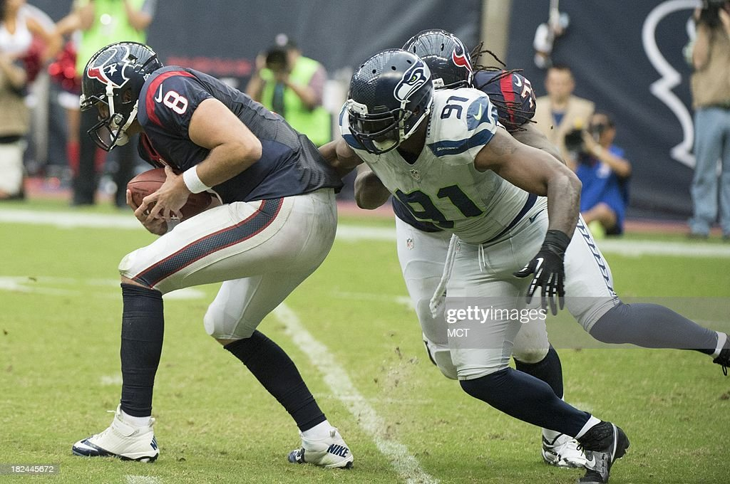 Matt Schaub (8) of the Houston Texans is sacked by Chris Clemons (91) of the Seattle Seahawks in the second half of a 23-20 Seattle overtime victory on Sunday, September 29, 2013, in Houston, Texas.