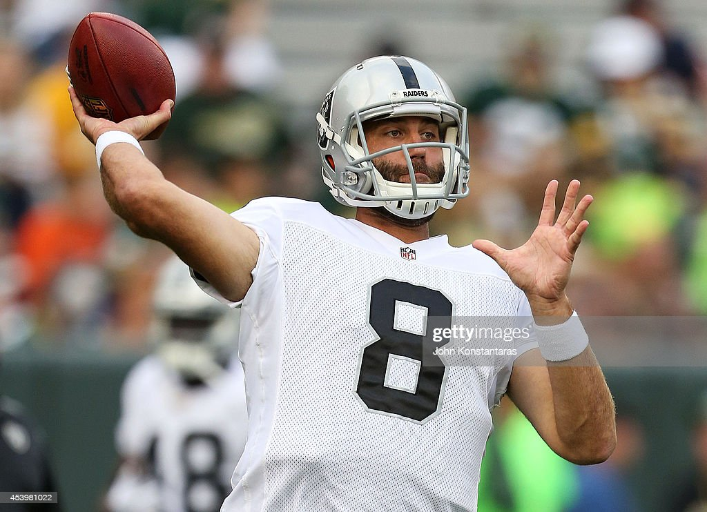 Matt Schaub #8 of the Oakland Raiders warms up prior to a preseason game against the Green Bay Packers at Lambeau Field on August 22, 2014 in Green Bay, Wisconsin.