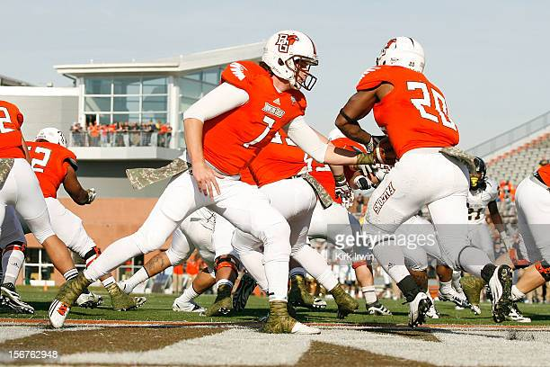 Matt Schilz of the Bowling Green Falcons hands the ball off to John Pettigrew of the Bowling Green Falcons during the game against the Kent State...