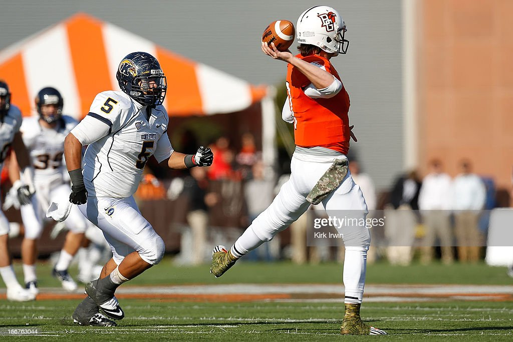 Matt Schilz #7 of the Bowling Green Falcons throws the ball while being chased by Roosevelt Nix #5 of the Kent State Golden Flashses on November 17, 2012 at Doyt Perry Stadium in Bowling Green, Ohio.