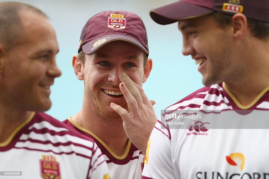 Matt Scott, Michael Morgan and Corey Oates share a joke during a Queensland Maroons State Of Origin captain's run at ANZ Stadium on May 31, 2016 in Sydney, Australia.