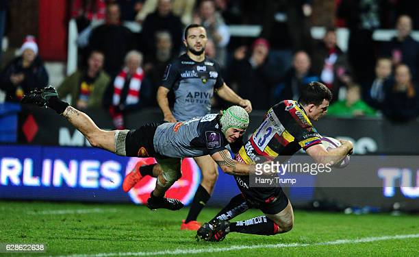 Matt Scott of Gloucester Rugby goes over for his side's try during the European Rugby Challenge Cup match between Gloucester Rugby and La Rochelle at...