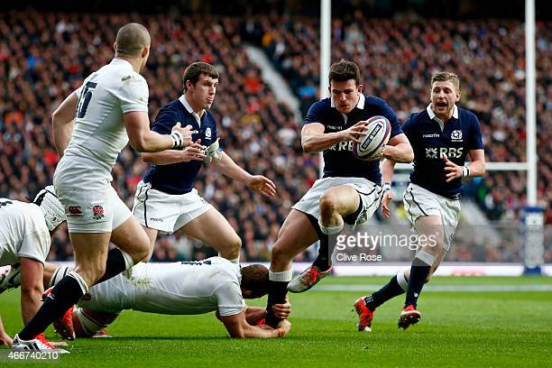 Matt Scott of Scotland is tackled by Chris Robshaw of England during the RBS Six Nations match between England and Scotland at Twickenham Stadium on...