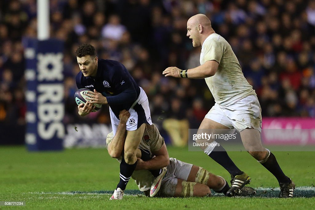 Matt Scott of Scotland is tackled by <a gi-track='captionPersonalityLinkClicked' href=/galleries/search?phrase=George+Kruis&family=editorial&specificpeople=6179640 ng-click='$event.stopPropagation()'>George Kruis</a> and <a gi-track='captionPersonalityLinkClicked' href=/galleries/search?phrase=Dan+Cole&family=editorial&specificpeople=4166468 ng-click='$event.stopPropagation()'>Dan Cole</a> of England during the RBS Six Nations match between Scotland and England at Murrayfield Stadium on February 6, 2016 in Edinburgh, Scotland.