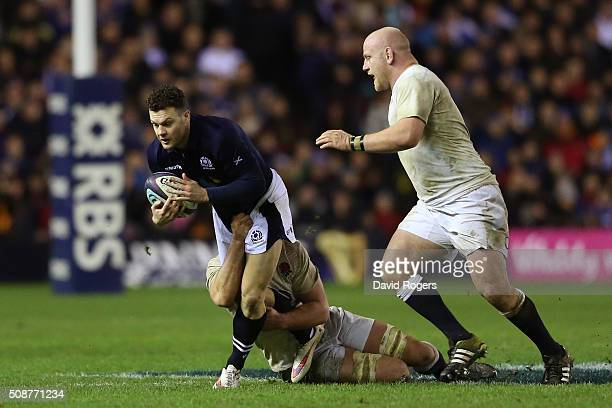 Matt Scott of Scotland is tackled by George Kruis and Dan Cole of England during the RBS Six Nations match between Scotland and England at...
