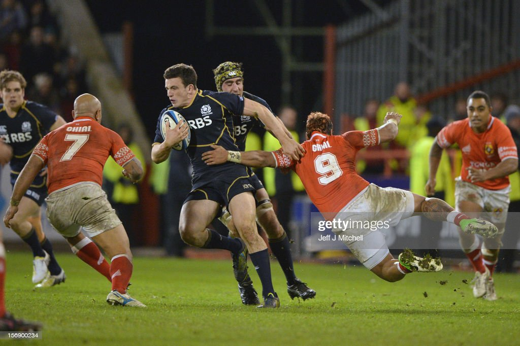 <a gi-track='captionPersonalityLinkClicked' href=/galleries/search?phrase=Matt+Scott+-+Rugby+Union+Player&family=editorial&specificpeople=15066775 ng-click='$event.stopPropagation()'>Matt Scott</a> of Scotland is tackled by <a gi-track='captionPersonalityLinkClicked' href=/galleries/search?phrase=Taniela+Moa&family=editorial&specificpeople=676749 ng-click='$event.stopPropagation()'>Taniela Moa</a> and <a gi-track='captionPersonalityLinkClicked' href=/galleries/search?phrase=Nili+Latu&family=editorial&specificpeople=686673 ng-click='$event.stopPropagation()'>Nili Latu</a> of Tonga during the international match between Scotland and Tonga at Pittodrie stadium on November 24, 2012 in Aberdeen,Scotland.