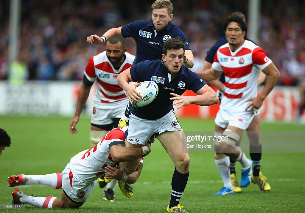 <a gi-track='captionPersonalityLinkClicked' href=/galleries/search?phrase=Matt+Scott+-+Rugby+Union+Player&family=editorial&specificpeople=15066775 ng-click='$event.stopPropagation()'>Matt Scott</a> of Scotland is tackled during the 2015 Rugby World Cup Pool B match between Scotland and Japan at Kingsholm Stadium on September 23, 2015 in Gloucester, United Kingdom.