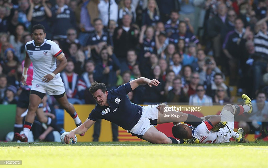 <a gi-track='captionPersonalityLinkClicked' href=/galleries/search?phrase=Matt+Scott+-+Rugby+Union+Player&family=editorial&specificpeople=15066775 ng-click='$event.stopPropagation()'>Matt Scott</a> of Scotland scores his teams fourth try during the 2015 Rugby World Cup Pool B match between Scotland and USA at Elland Road on September 27, 2015 in Leeds, United Kingdom.