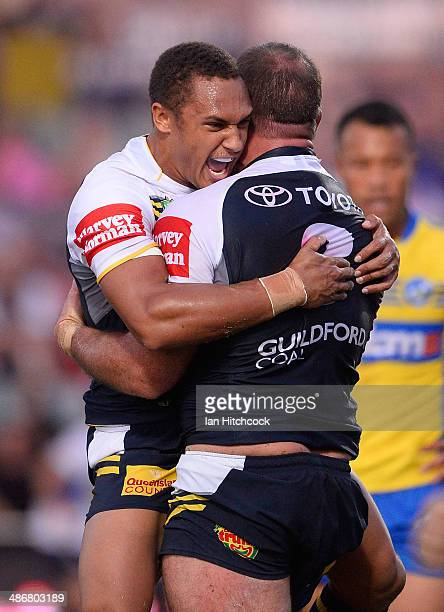 Matt Scott of the Cowboys celebrates with Ray Thompson after scoring a try during the round 8 NRL match between the North Queensland Cowboys and the...