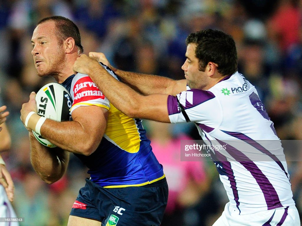 Matt Scott of the Cowboys is tackled by <a gi-track='captionPersonalityLinkClicked' href=/galleries/search?phrase=Cameron+Smith+-+Rugbyer&family=editorial&specificpeople=453295 ng-click='$event.stopPropagation()'>Cameron Smith</a> of the Storm during the round two NRL match between the North Queensland Cowboys and the Melbourne Storm at 1300SMILES Stadium on March 16, 2013 in Townsville, Australia.