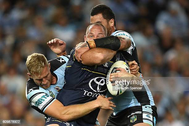 Matt Scott of the Cowboys is tackled during the NRL Preliminary Final match between the Cronulla Sharks and the North Queensland Cowboys at Allianz...
