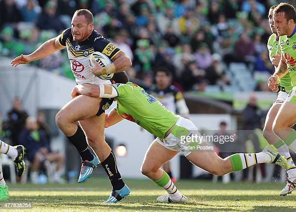 Matt Scott of the Cowboys is tackled during the round 15 NRL match between the Canberra Raiders and the North Queensland Cowboys at GIO Stadium on...