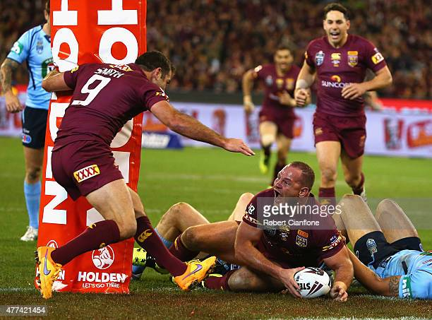 Matt Scott of the Maroons celebrates after scoring a try during game two of the State of Origin series between the New South Wales Blues and the...