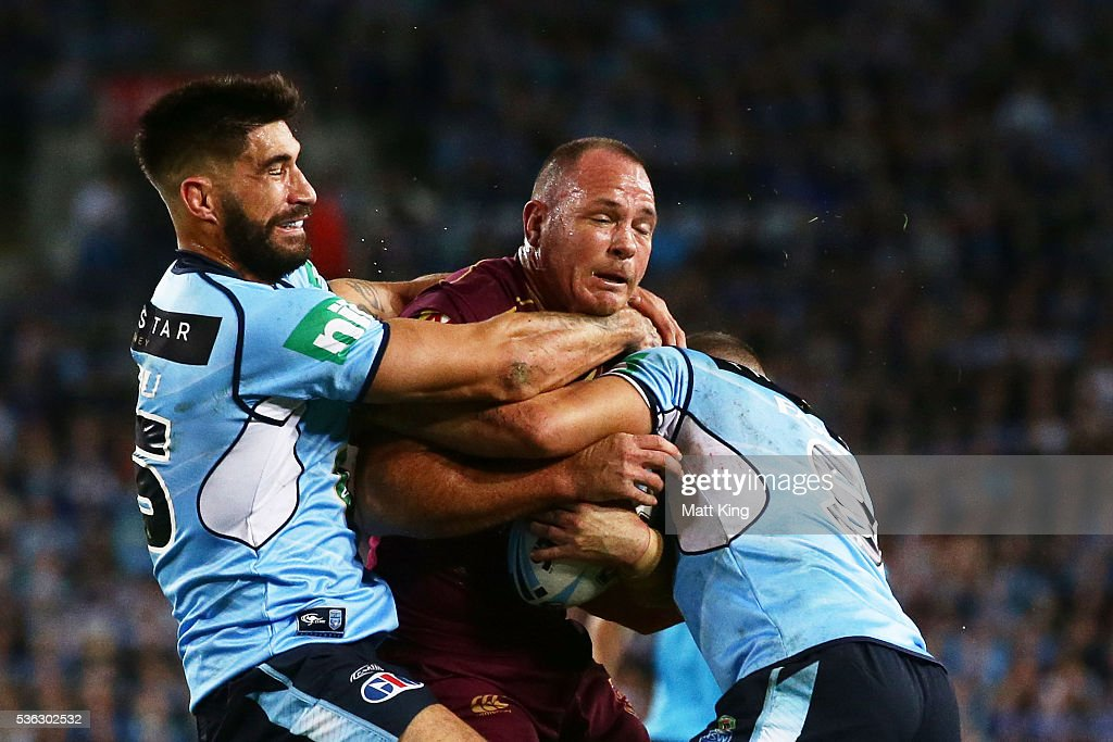 Matt Scott of the Maroons is tackled during game one of the State Of Origin series between the New South Wales Blues and the Queensland Maroons at ANZ Stadium on June 1, 2016 in Sydney, Australia.