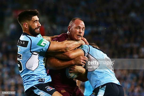 Matt Scott of the Maroons is tackled during game one of the State Of Origin series between the New South Wales Blues and the Queensland Maroons at...