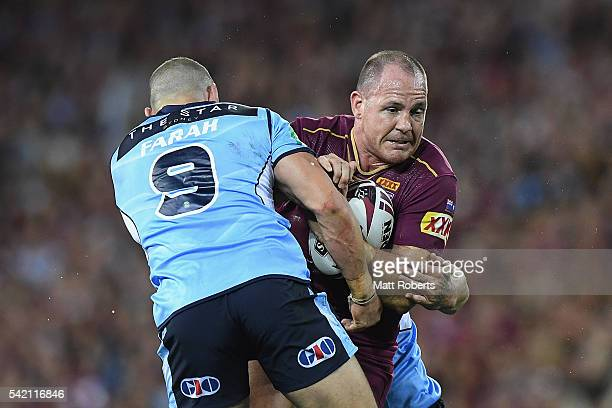 Matt Scott of the Maroons is tackled during game two of the State Of Origin series between the Queensland Maroons and the New South Wales Blues at...