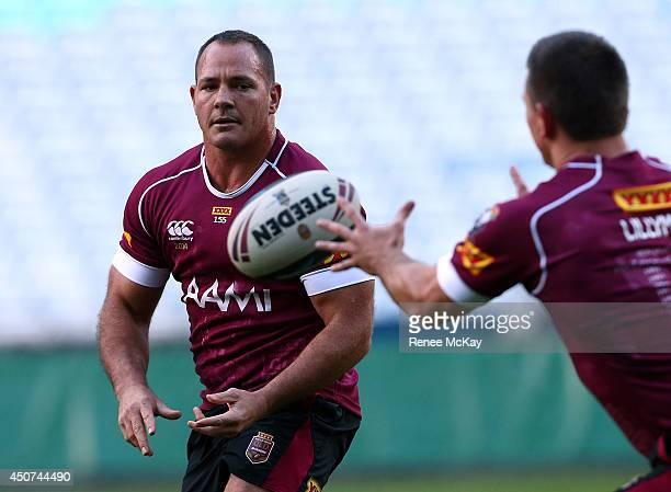 Matt Scott passes the ball during a Queensland Maroons State of Origin training session at ANZ Stadium on June 17 2014 in Sydney Australia