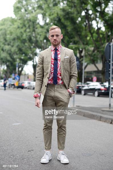 Matt Sebra poses wearing a J Crew suit Zara shirt APC tie and Adidas shoes before Giorgio Armani show on June 24 2014 in Milan Italy