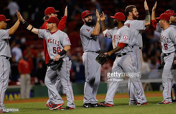 Matt Shoemaker of the Los Angeles Angels celebrates a 20 victory with teammates against the Boston Red Sox in the first inning at Fenway Park on...