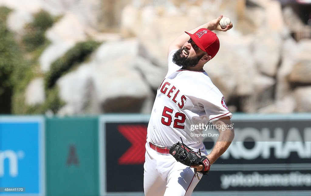 <a gi-track='captionPersonalityLinkClicked' href=/galleries/search?phrase=Matt+Shoemaker&family=editorial&specificpeople=9008681 ng-click='$event.stopPropagation()'>Matt Shoemaker</a> #52 of the Los Angeles Angels of Anaheim throws a pitch against the Oakland Athletics at Angel Stadium of Anaheim on August 31, 2014 in Anaheim, California.