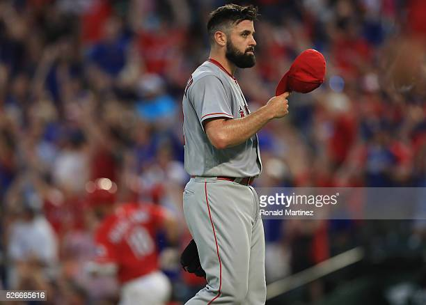Matt Shoemaker of the Los Angeles Angels reacts after giving up a three run homerun against Mitch Moreland of the Texas Rangers in the third inning...