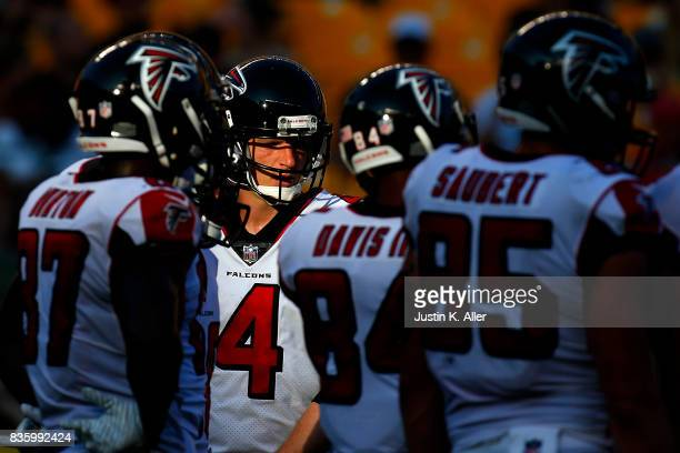Matt Simms of the Atlanta Falcons looks on in the huddle in the second half against the Pittsburgh Steelers during a preseason game at Heinz Field on...