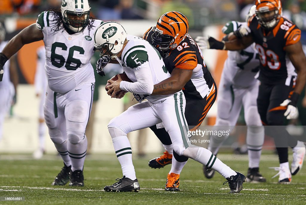 Matt Simms #5 of the New York Jets is sacked by James Harrison #92 of the Cincinnati Bengals during the game at Paul Brown Stadium on October 27, 2013 in Cincinnati, Ohio.